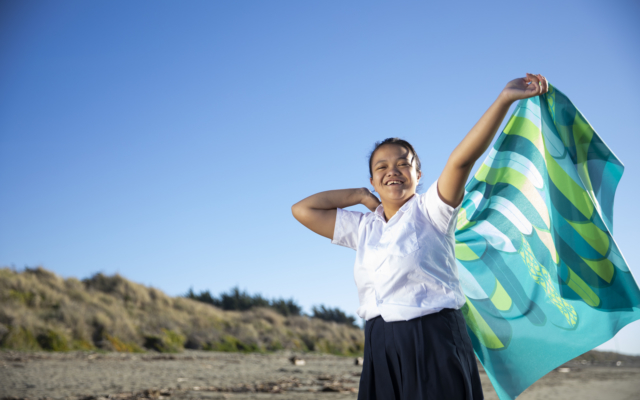 Girl on beach with flag
